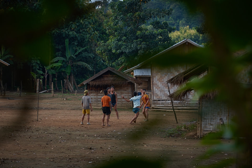 Teenagers entertain themselves by playing footvolley during the late hours of the day