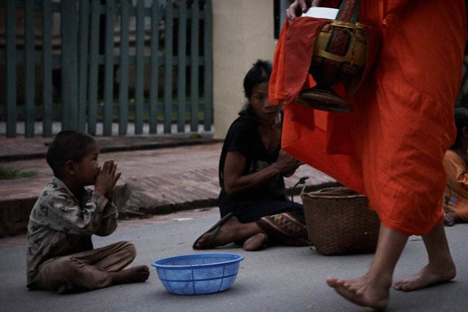 Many poor people are the receptors of the alms from the monks
