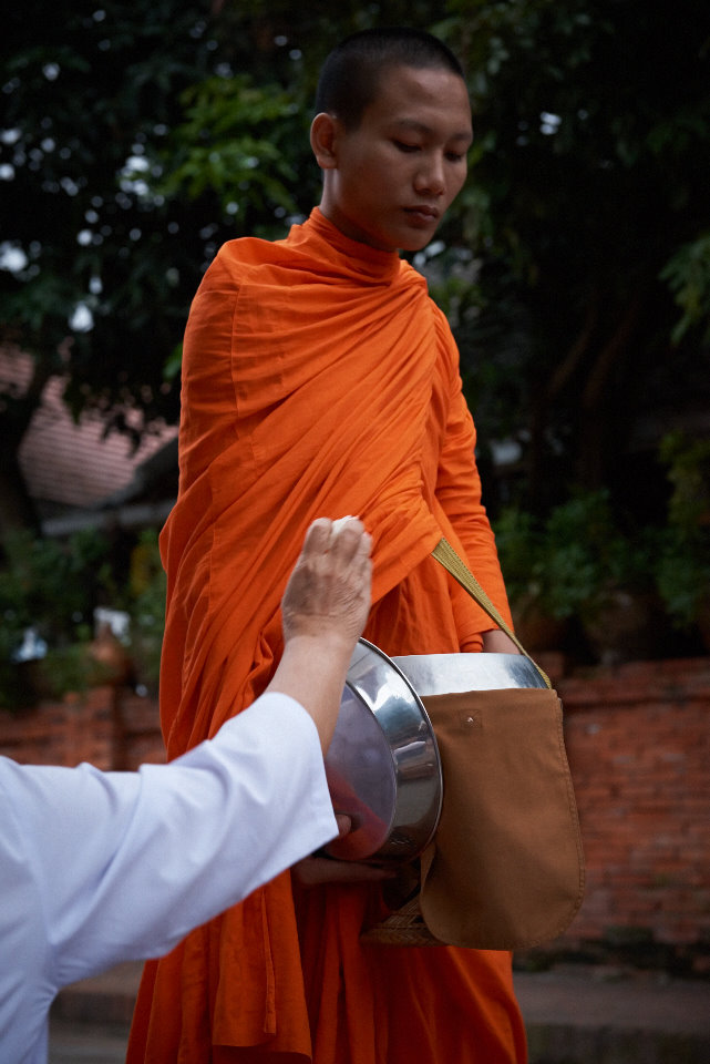 The rich people in Luang Prabang offer alms to the monks